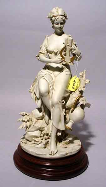 406B: BISQUE FIGURE OF A YOUNG WOMAN PLAYING A HARP, si