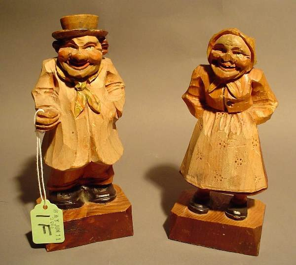1F: PAIR OF CARVED FOLK ART FIGURES OF AN OLD MAN AND W