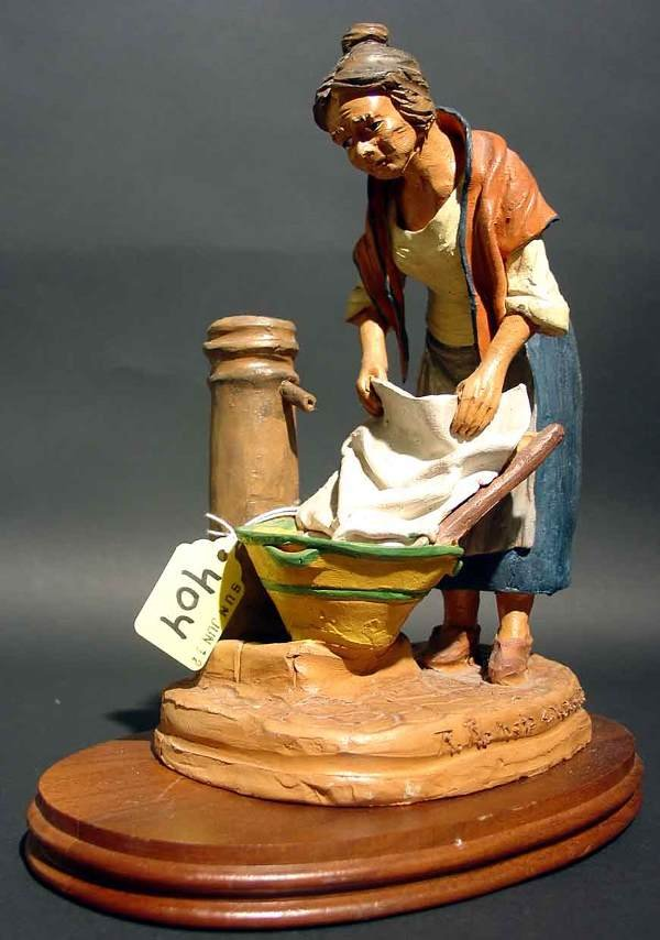 404: CERAMIC FIGURE OF A WASHER-WOMAN AT THE WATER PUMP