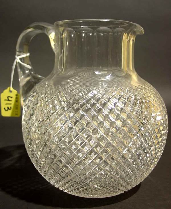 413: FINELY CUT CRYSTAL PITCHER, having an overall diam