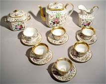 1107: FIFTEEN-PIECE FLORAL DECORATED AND GILDED OLD PAR