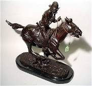 1187: AFTER FREDERIC REMINGTON, patinated bronze figure