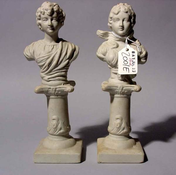2001E: PAIR OF UNDECORATED BISQUE BUSTS, depicted in a