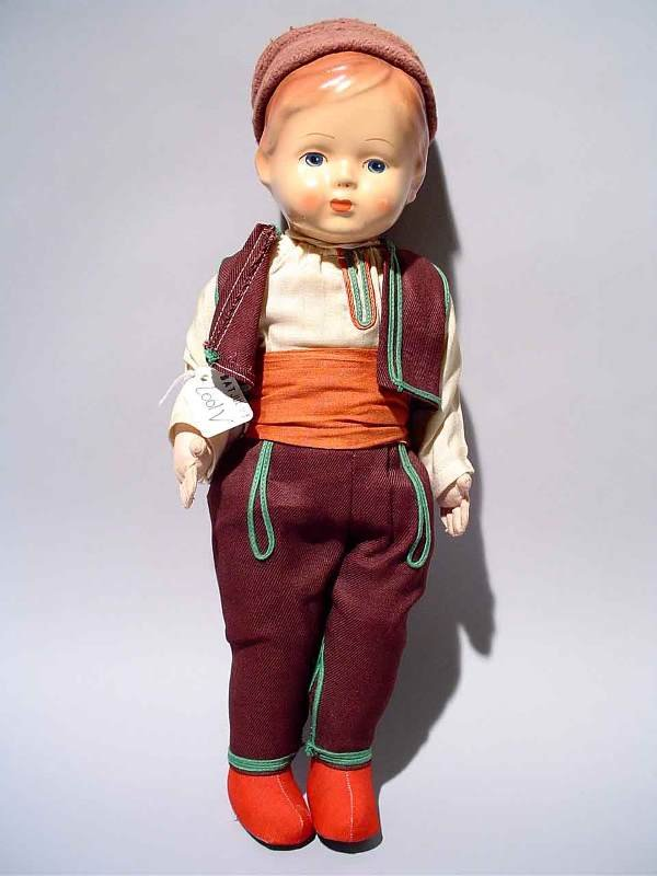 2001V: COMPOSITION AND FABRIC DOLL, modeled as a young