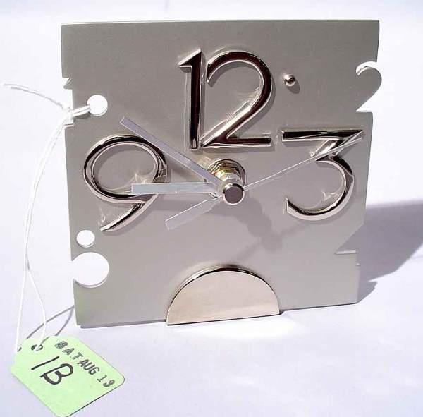 1B: SATIN FINISH SILVERPLATED DESK CLOCK, having an Art