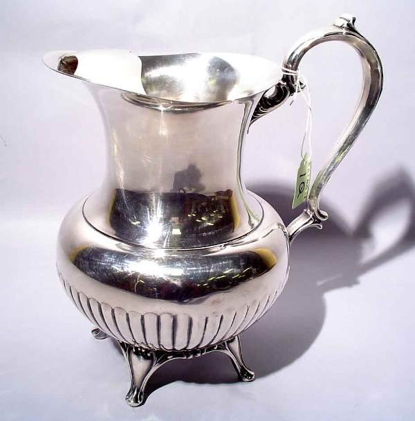 1Q: SILVERPLATED FOOTED WATER PITCHER, by Wm. A. Rogers