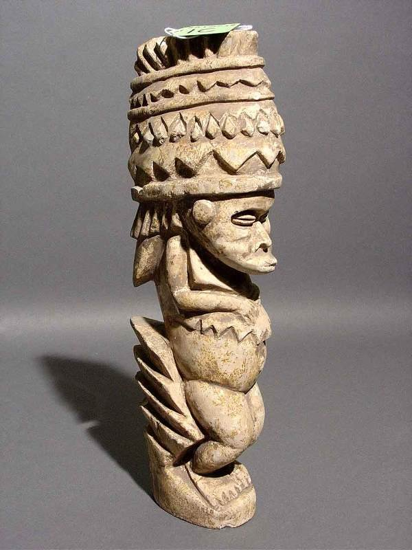 1C: MELANESIAN CARVED STONE FIGURE, depicting a man wea