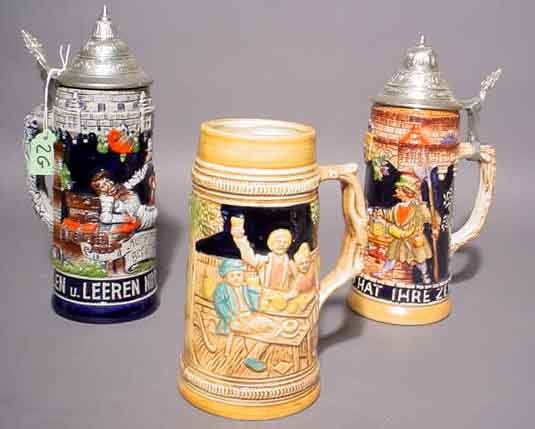 1K: LOT OF THREE CERAMIC BEER STEINS, with raised decor