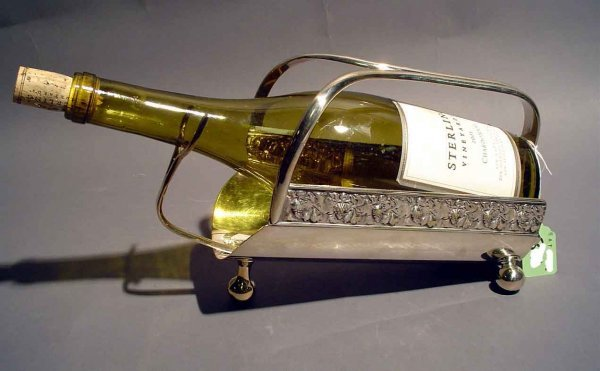 1F: SILVERPLATED WINE BOTTLE CADDY WITH FOLIATE EMBOSSI