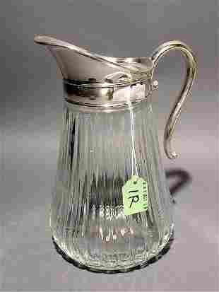 SILVERPLATED AND MOULDED GLASS PITCHER, having a sc