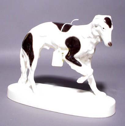 407: DECORATED PORCELAIN FIGURE OF A BORZOI, by Schn