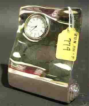 1001E: SILVERPLATED FREE FORM DESIGN DESK CLOCK, having