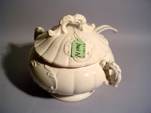 1001N: GLAZED CERAMIC COVERED TUREEN AND LADLE, having