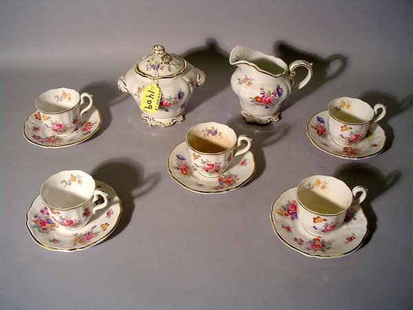 1409: 18-PIECE FLORAL DECORATED CHINA TEA SERVICE, incl