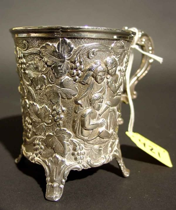 1420: HEAVILY CAST SILVERPLATED CHASED FOOTED CUP, of c