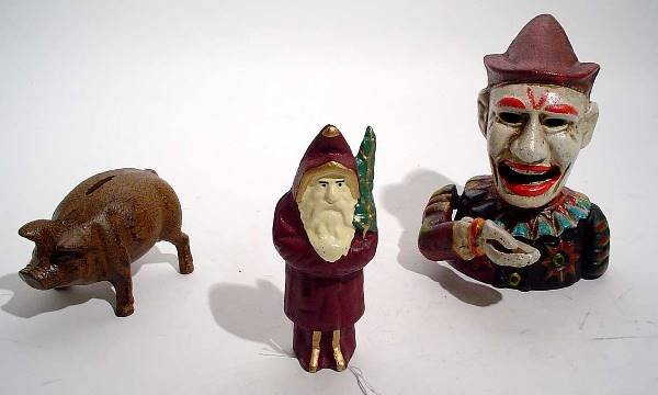 """404A: """"LOT OF 3 CAST IRON TOY BANKS, depicting a Santa"""
