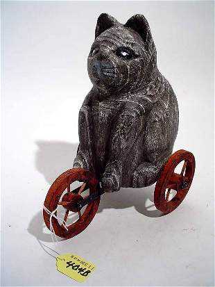 CARVED CAT ON WHEELS TOY