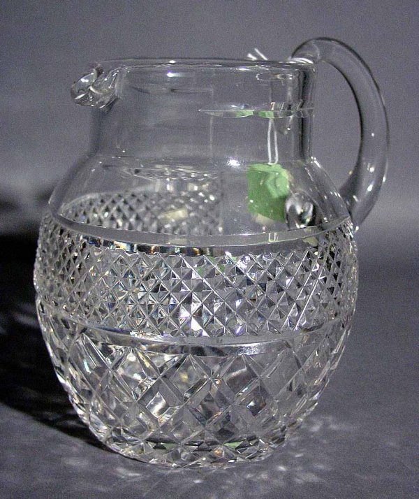 13: CUT CRYSTAL PITCHER, having two registers of diamon