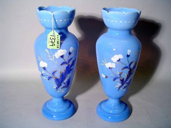 7: PAIR OF FLORAL ENAMEL DECORATED GLASS VASES, of pede