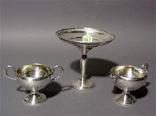 LOT OF A STERLING SILVER COMPOTE, SUGAR AND CREAMER