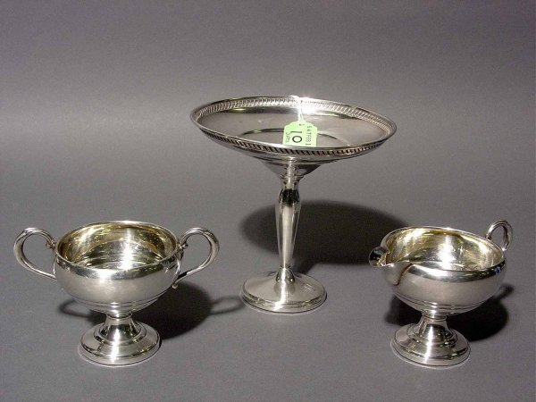 10: LOT OF A STERLING SILVER COMPOTE, SUGAR AND CREAMER