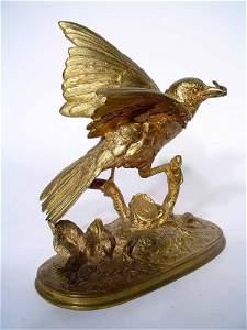 85: WELL-MODELED GILT BRONZE FIGURE OF A BIRD ON A BRAN