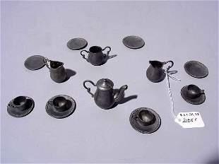 MINIATURE PEWTER SIXTEEN-PIECE DOLL-SIZE TEA SET,