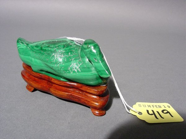 419: CARVED MALACHITE FIGURE OF A DUCK, depicted nestin