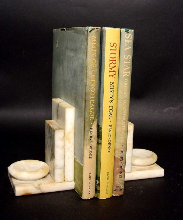 1: PAIR OF VEINED MARBLE BOOKENDS, depicted as a pair o