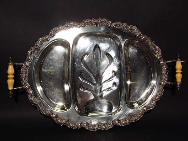 13: OVAL SILVERPLATED WELL AND TREE FOOTED TRAY, circa