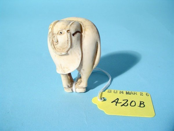 420B: JAPANESE CARVED IVORY NETSUKE OF AN OX, 20th cent
