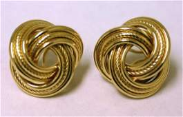 600: PAIR OF 14 KT. YELLOW GOLD KNOT DESIGN EARRINGS, w