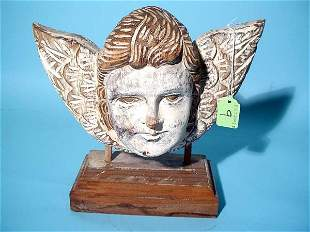CARVED AND GESSOED WOOD WINGED CHERUB HEAD, 20th cen