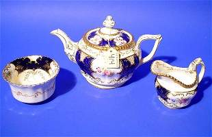 THREE-PIECE COALPORT FLORAL AND GILT DECORATED IND