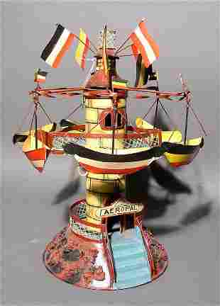 TABLE TOP MECHANICAL DECORATED METAL CARNIVAL BOAT