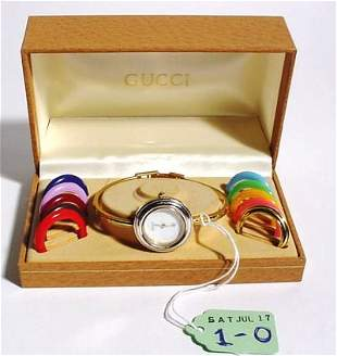 LADY'S GUCCI WRISTWATCH IN CASE WITH INTERCHANGABLE