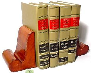 PAIR OF LEATHER COVERED BOOKENDS