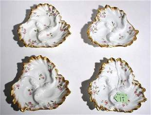 SET OF FOUR DECORATED AND GILDED LIMOGES SMALL DISH