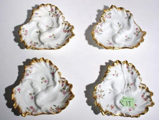 1T: SET OF FOUR DECORATED AND GILDED LIMOGES SMALL DISH