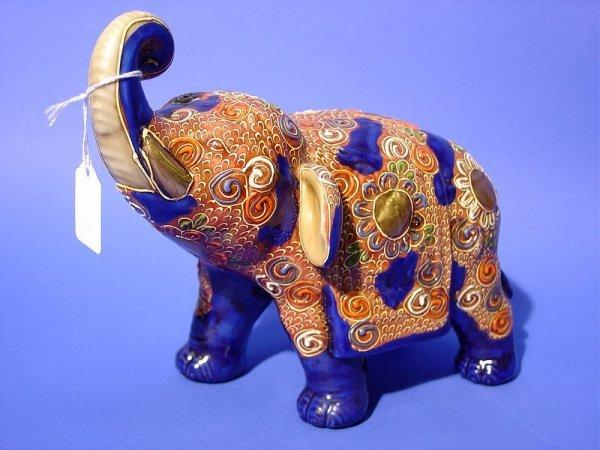 1003: SATSUMA DECORATED FIGURE OF AN ELEPHANT WITH RAIS