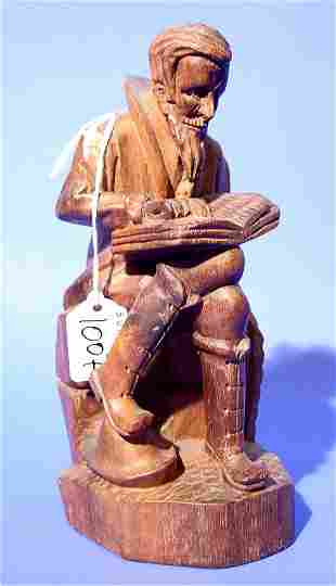 CARVED AND STAINED WOODEN SCULPTURE OF A SCHOLAR,