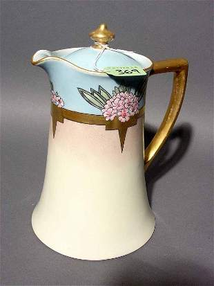 LIMOGES DECORATED AND GILDED CHOCOLATE POT, circa