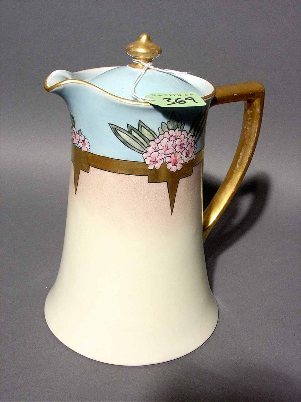 1010: LIMOGES DECORATED AND GILDED CHOCOLATE POT, circa