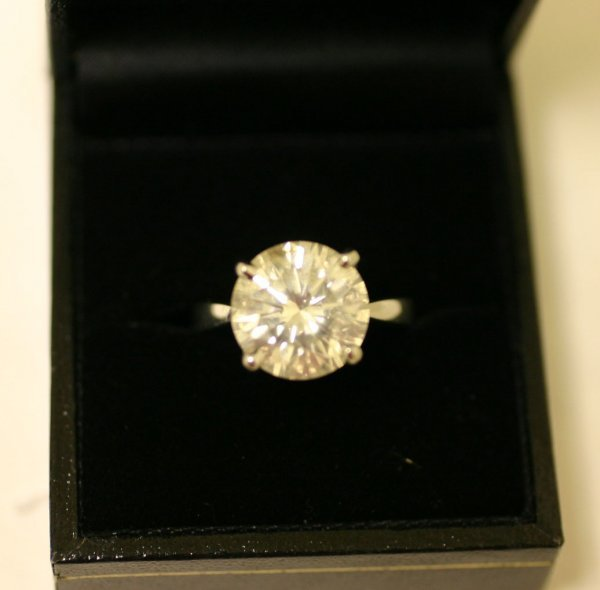 1193: PLATINUM AND DIAMOND SOLITAIRE RING, the  round b