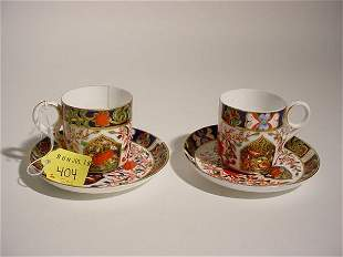 PAIR OF DERBY PORCELAIN DEMITASSE CUPS AND SAUCERS