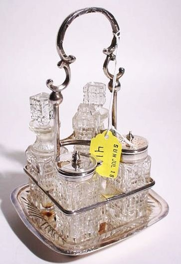 411: SMALL SILVERPLATED AND CUT CRYSTAL FIVE BOTTLE CRU