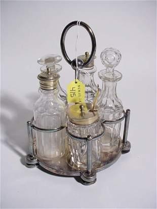 SILVERPLATED FIVE-BOTTLE CUT GLASS CRUET SET