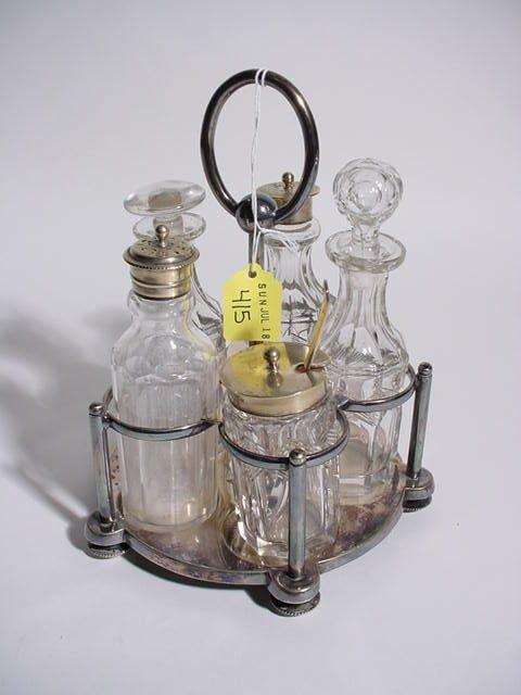 415: SILVERPLATED FIVE-BOTTLE CUT GLASS CRUET SET