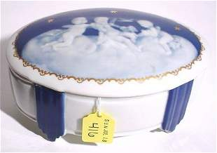 PATE-SUR-PATE STYLE DECORATED PORCELAIN OVAL BOX