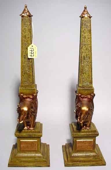 402: PAIR OF GILT DECORATED COMPOSITION FIGURAL OBELISK